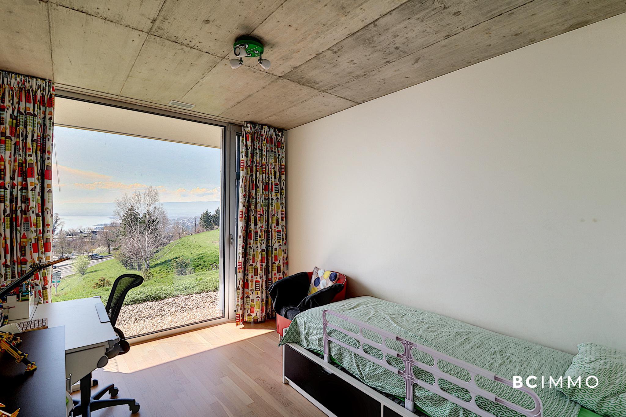 BC Immo - Contemporain avec une vue panoramique - 1091HB21A